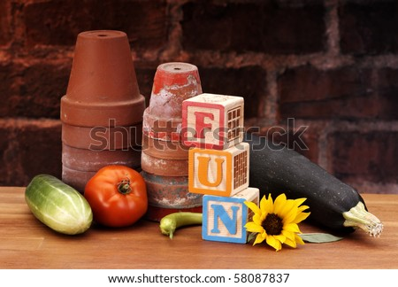 Pots blocks and garden food spelling FUN - stock photo