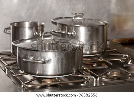 Pots of food in an industrial kitchen