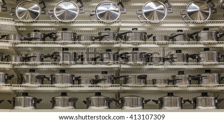 Pots on the shelves in the store sold - stock photo