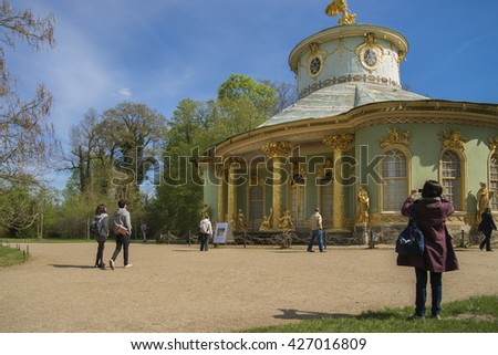 POTSDAM - APR 29 : Unidentified people walking in Sanssouci gardens  on April 29, 2015 in Potsdam, Germany.