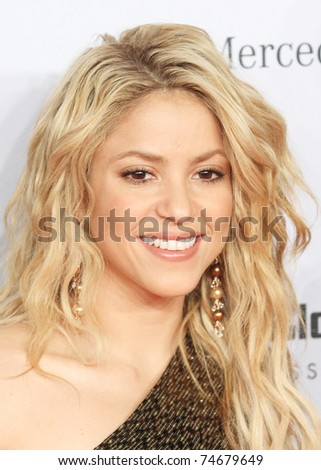 POTSDAM, GERMANY - NOVEMBER 11: Shakira poses on the red carpet for the Bambi 2010 Award at Filmpark Babelsberg. November 11, 2010 in Potsdam, Germany. - stock photo