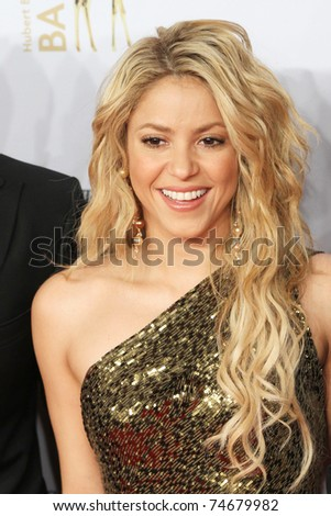 POTSDAM, GERMANY - NOVEMBER 11: Shakira poses on the red carpet for the Bambi 2010 Award at Filmpark Babelsberg on November 11, 2010 in Potsdam, Germany. - stock photo
