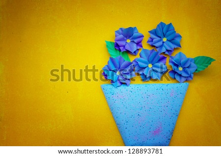 Potted flowers on a yellow background - stock photo