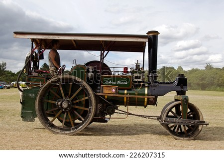POTTEN END, UK - JULY 27: A large vintage traction engine leaves the parade grounds heading toward the vehicle preparation area at the Dacorum Steam fair on July 27, 2014 in Potten End