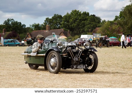 POTTEN END, UK - JULY 27: A 1933 Morgan supersport three wheeler leaves the show ground having given a display to the public at the Dacorum Steam & Country fair on July 27, 2014 in Potten End - stock photo