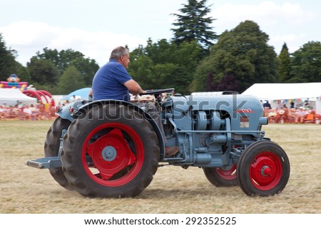 POTTEN END, UK - JULY 27: A vintage Eicher tractor is paraded around the main arena as part of the agricultural machinery show at the Dacorum Steam & Country fair on July 27, 2014 in Potten End