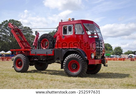 POTTEN END, UK - JULY 27: An ex military Matador recovery truck is displayed for the public to watch its lifting capabilities  at the Dacorum Steam & Country fair on July 27, 2014 in Potten End - stock photo