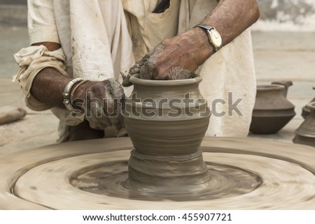 Potter Hands Making Pottery in Clay on Wheel