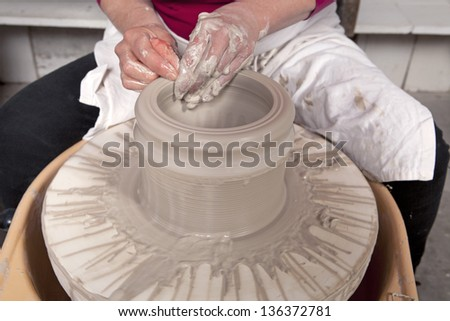 Potter making a new creation - stock photo
