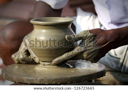 Potter's Hands Creating New Pot - stock photo