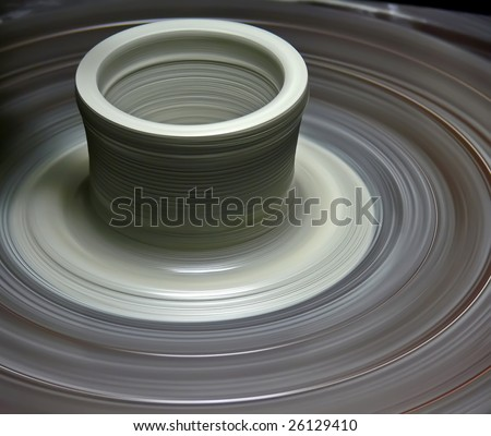 Potter's wheel with a new pot rotating - stock photo