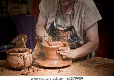 Potter working at his workshop. - stock photo