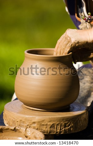 Potters hands working on new pot project - stock photo