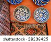 Pottery and a carpet at the medina of Marrakesh,Morocco - stock photo