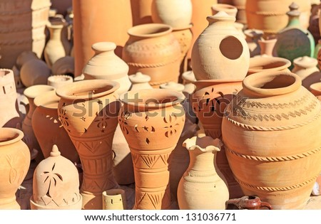 Pottery and Different Handicrafts at Nizwa Market in Nizwa, Oman - stock photo
