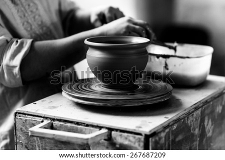 Pottery Craft Ceramic Clay In Potter Human Hand. Toned Instant Photo - stock photo