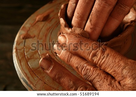 pottery craftsmanship red clay potter hands work finger closeup