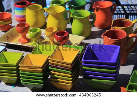 Pottery in bright colors at a market in the Provence