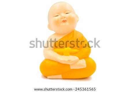 pottery monk on white background - stock photo