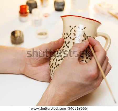 Pottery. Painting pottery. - stock photo