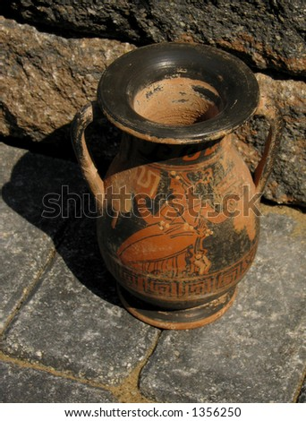 pottery urn on tuscan piazza - stock photo