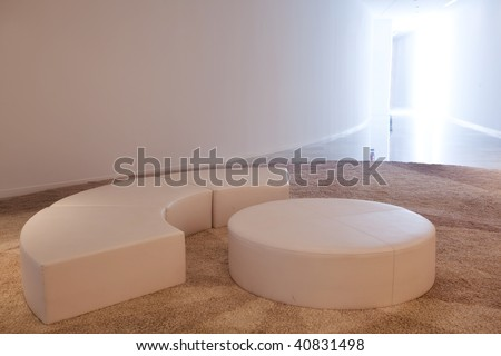 Poufs on carpet in an empty room. - stock photo