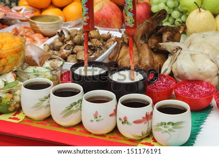 Poultry and tea offerings for the gods. - stock photo