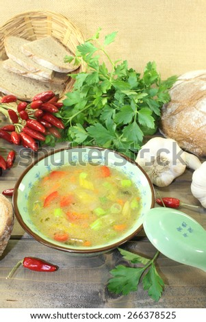 Poultry consomme with chicken skewers on a napkin - stock photo