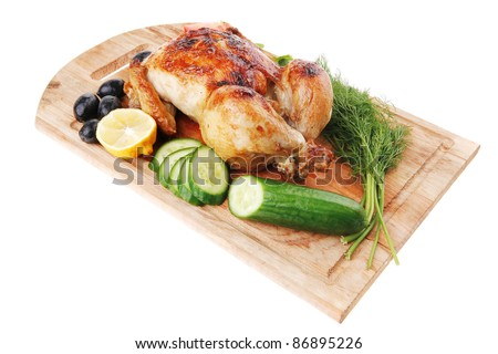 poultry : homemade roast turkey with greek olives and tomatoes on wooden board isolated over white background - stock photo