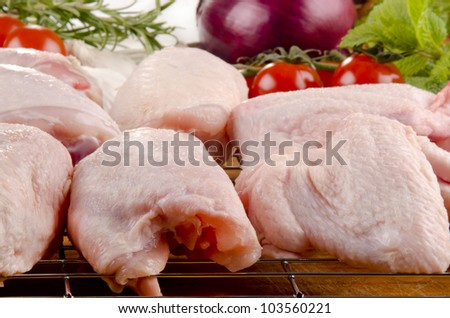 poultry parts before preparation and vegetable - stock photo