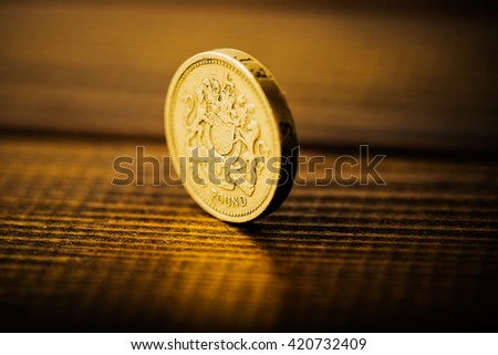 pound GBP coin on the desk  - stock photo