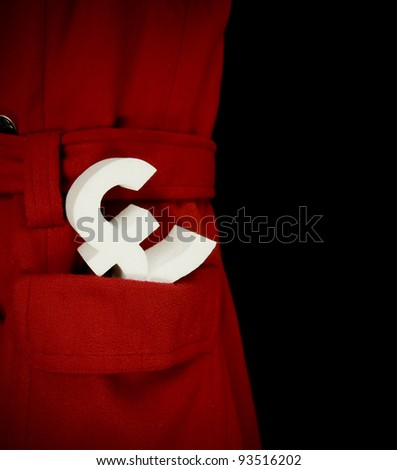 Pound in your pocket, an English Pound symbol in a coat pocket - stock photo