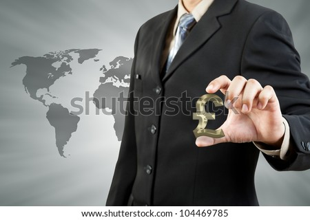 Pound symbol in businessman hand - stock photo