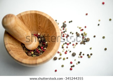 Pounder with different sorts of pepper - stock photo