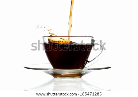 Pour coffee into glass cup, isolated on white background. - stock photo