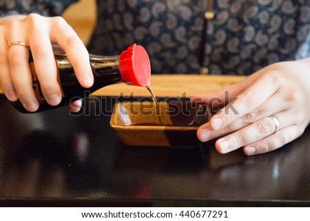 pour soy sauce - stock photo