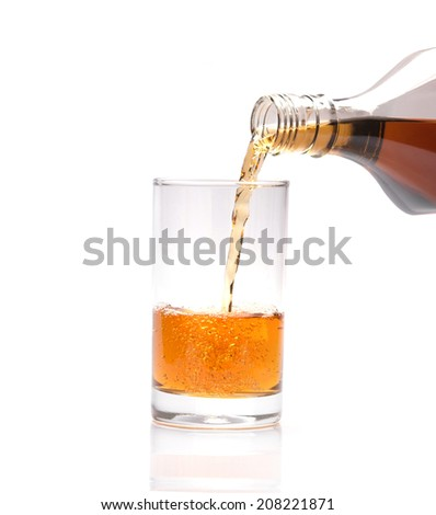 Pour whisky into glass - stock photo