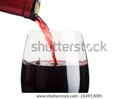 Pour wine into glass isolated on white background - stock photo