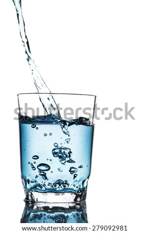 Poured water into glass isolated on white background