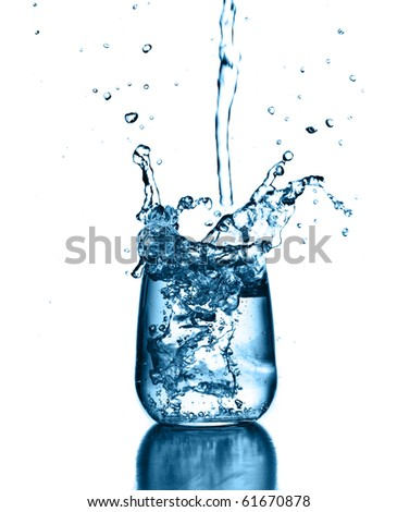 pourig water on glass - stock photo