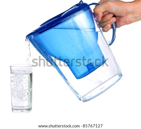 Pouring a glass of purified water isolated on white background - stock photo