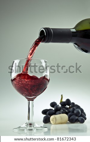 Pouring a glass of red wine - stock photo