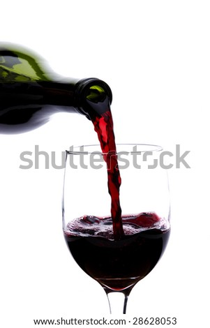 Pouring a glass of red wine into a glass on a white background - stock photo