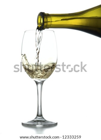 Pouring a glass of white wine on white background