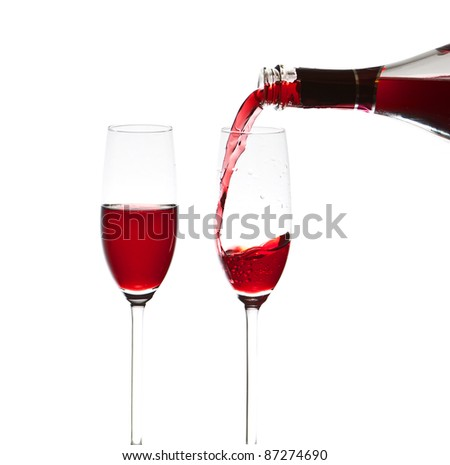 Pouring a glass of wine, close-up - stock photo