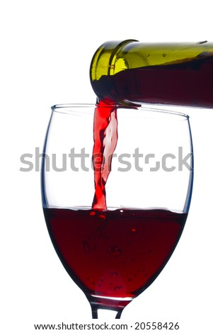 pouring a red wine in glass - stock photo