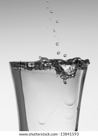 Pouring a shot of vodka. - stock photo