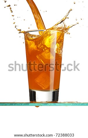 Pouring an orange drink - stock photo
