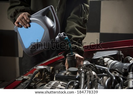 Pouring Antifreeze - stock photo