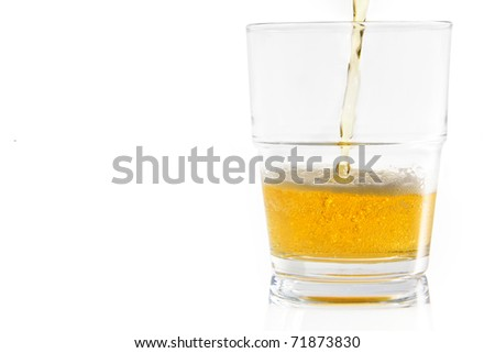 Pouring beer into a glass; isolated on a white background with clipping path